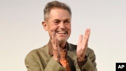 "FILE - In this Sept. 13, 2016, photo, Jonathan Demme, director of the concert film ""Justin Timberlake + The Tennessee Kids,"" appears at the premiere at the Toronto International Film Festival. Demme died April 26, 2017, of complications from esophageal cancer in New York. He was 73."