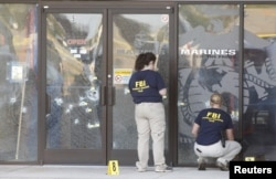 FBI agents work the scene at the Armed Forces Career Center in Chattanooga, Tennessee, July 16, 2015.