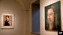 "A photograph of John Leguizamo, left, byTimothy Greenfield-Sanders, and a painting of Brad Pitt by Colin Davidson, right, are among the works on display in ""Eye Pop: The Celebrity Gaze,"" at the National Portrait Gallery, May 18, 2015, in Washington."