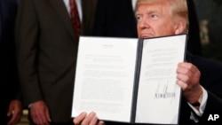 美國總統川普2017年8月14日簽署備忘錄,對中國進行貿易調查