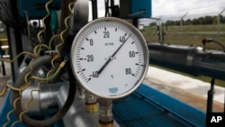 FILE - A gas pressure gauge in the boosting compressor station ''East-Poltava'' near the village of Kovalivka, Poltava region, Ukraine, June 27, 2014.