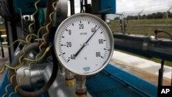 FILE - A gas pressure gauge in the boosting compressor station ''East-Poltava'' near the village of Kovalivka, Poltava region, Ukraine, June 27, 2014.