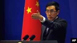 China's Foreign Ministry spokesman Liu Weimin gestures during a news conference in Beijing (file photo).