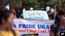 FILE - Ugandans take part in the 3rd Annual Lesbian, Gay, Bisexual and Transgender (LGBT) Pride celebrations in Entebbe, Uganda, Aug. 9, 2014.