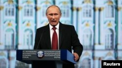 Russia's President Vladimir Putin delivers a speech during a session of the St. Petersburg International Economic Forum 2014 in St. Petersburg, May 23, 2014.
