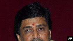Maharashtra state Chief Minister Ashok Chavan looks on during a press conference at his residence after submitting his resignation, in Mumbai, India, 9 Nov 2010.