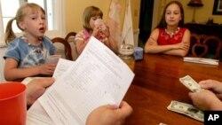 Allowances can help teach children about money.