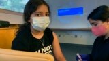 FILE - Maya Huber takes part in Pfizer COVID-19 vaccine study at Rutgers University on June 14 2021 in New Brunswick, N.J. Maya does not know if she is receiving the vaccine or the placebo. (Nisha Gandhi via AP)