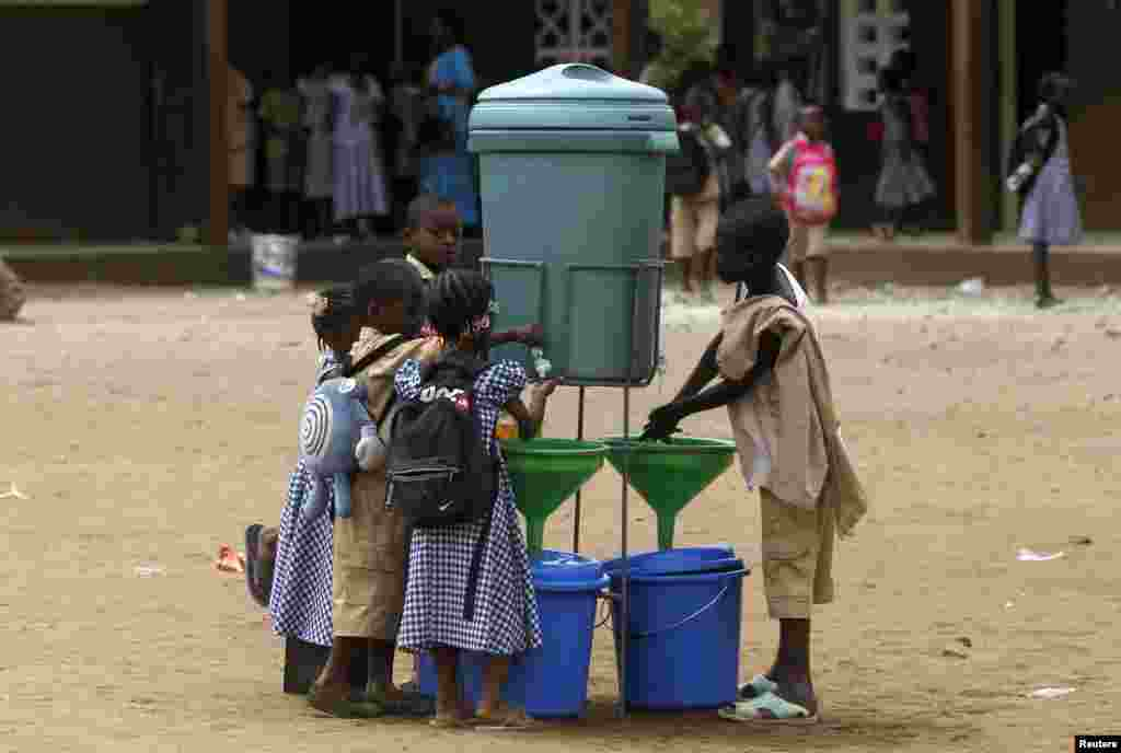 Students wash their hands as a preventive measure against Ebola at Anono school in Abidjan, Ivory Coast, Sept. 25, 2014.