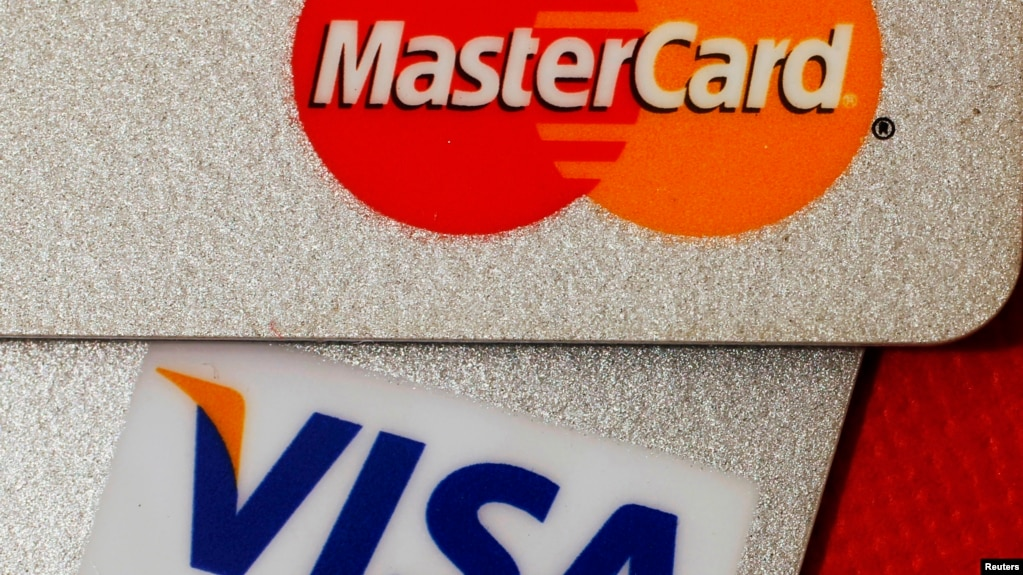 Us bank card companies to seek licenses to operate in china in months file mastercard and visa credit cards are seen in this illustrative photograph taken in hong reheart Image collections