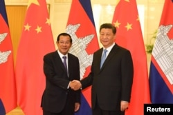In this photo taken on April 29, 2019, Cambodia's Prime Minister Hun Sen shook hands with China's President Xi Jinping before their meeting at the Great Hall of the People in Beijing, China.