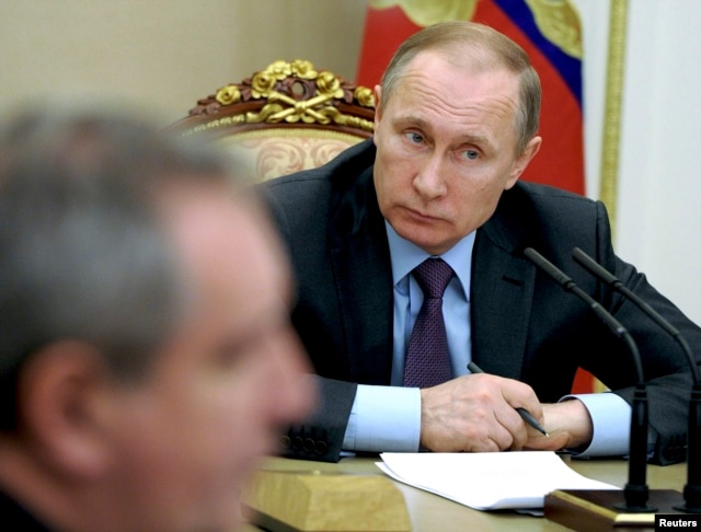 FILE - Russian President Vladimir Putin chairs a meeting on counterwork against corruption at the Kremlin in Moscow, Russia, Jan. 26, 2016.