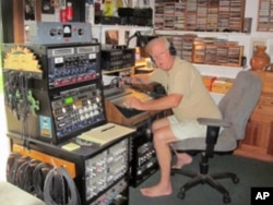 Jake Rohrer in his garage recording studio