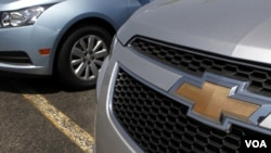 A detail of the grill of a 2011 Chevrolet Cruze compact car, right, is seen near another Chevrolet Cruze, left, on the lot of a dealership, in Norwood, Mass., Tuesday, May 31, 2011. General Motors' U.S. sales fell 1.2 percent in May as it offered fewer de
