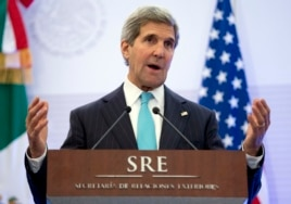 U.S. Secretary of State John Kerry gestures as he speaks during a joint news conference with Mexican Foreign Secretary Jose Antonio Meade in Mexico City, May 21, 2014.