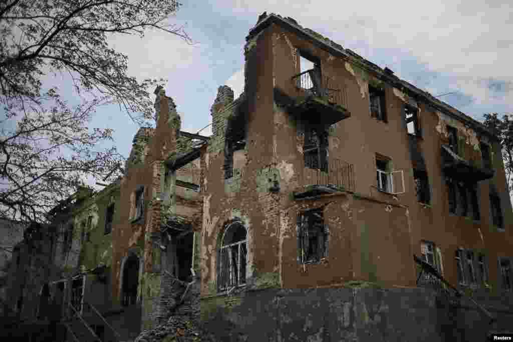 Buildings damaged by a recent shelling are seen in the eastern Ukrainian village of Semenovka, July 9, 2014.