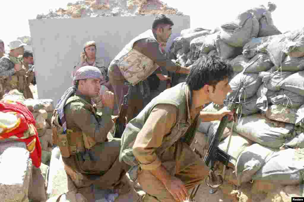 Kurdish peshmerga forces clash with Islamic State militants in the town of Daquq, south of Kirkuk, Sept. 30, 2014.