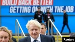Britain's Prime Minister Boris Johnson walks through the Conservative Party annual conference venue, in Manchester, Britain, Oct. 3, 2021.