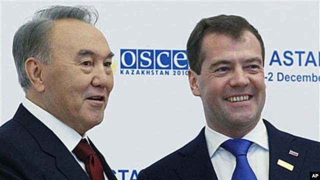 Russian President Dmitry Medvedev, right, and Kazakh President Nursultan Nazarbayev seen at the start of Organisation for Security and Cooperation in Europe meeting in Astana, Kazakhstan's capital, Dec. 1, 2010