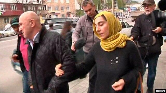 Journalists chase Zubeidat Tsarnaeva, front right, mother of Boston bombing suspects Dzhokhar, Tamerlan Tsarnaev, Makhachkala, Dagestan, April 23, 2013.