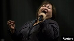 Rose Fostanes,47, a Filipina caregiver, performs during a rehearsal for Israel's X-Factor talent show in Tel Aviv, Jan. 12, 2014.
