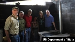 Special Representative Kris Balderston and a delegation of representatives from public and private sectors participate in building a clean cook stove in Antigua, Guatemala as part of the Global Partnership Initiative.