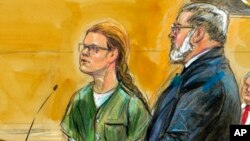 FILE - Maria Butina, left, is shown next to her attorney Robert Driscoll, in this courtroom sketch, before U.S. District Judge Tanya Chutkan at the U.S. District Court in Washington, Dec. 13, 2018.