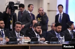 Mohammad Alloush (C), the head of the Syrian opposition delegation, attends Syria peace talks in Astana, Kazakhstan, Jan. 23, 2017.