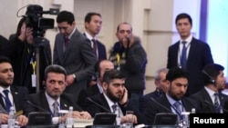 Mohammad Alloush (center), the head of the Syrian opposition delegation, attends Syria peace talks in Astana.