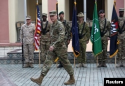 U.S. Army General John Nicholson strides at a ceremony welcoming him as the new commander of NATO and U.S. forces in Afghanistan, in Kabul, March 2, 2016.