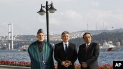 Presidents Hamid Karzai of Afghanistan, left, Abdullah Gul of Turkey, center, and Asif Ali Zardari of Pakistan pose for media in Istanbul, November 1, 2011.