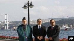 Presidents Hamid Karzai of Afghanistan, left, Abdullah Gul of Turkey, center, and Asif Ali Zardari of Pakistan pose for media in Istanbul, November 1, 2011.