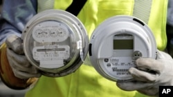 "FILE - New ""smart"" meter, right, will give customers, who are already using less energy, the opportunity to save money by accurately tracking consumption."