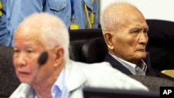 FILE - Khieu Samphan, left, former Khmer Rouge head of state, and Nuon Chea, Khmer Rouge's chief ideologist and No. 2 leader, sit in the court room before they made closing statements at the U.N.- backed war crimes tribunal in Phnom Penh, Oct. 31, 2013.