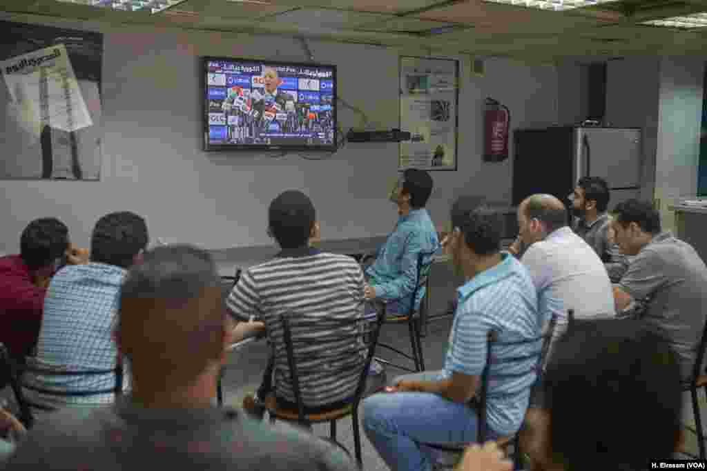 After Egypt's disqualification in Russia, Egyptian football fans watch a press conference at the headquarters of the Eyptian Football Association, where EFA President Hani Abo Rida explains the shortcomings of the team and its sponsors.