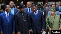 FILE - Ivory Coast's President Alassane Ouattara (L), Nigeria's President Goodluck Jonathan (2nd L), Benin's President Thomas Yayi Boni and Liberia President Ellen Johnson Sirleaf (R) are pictured at the 43rd (ECOWAS) Summit.