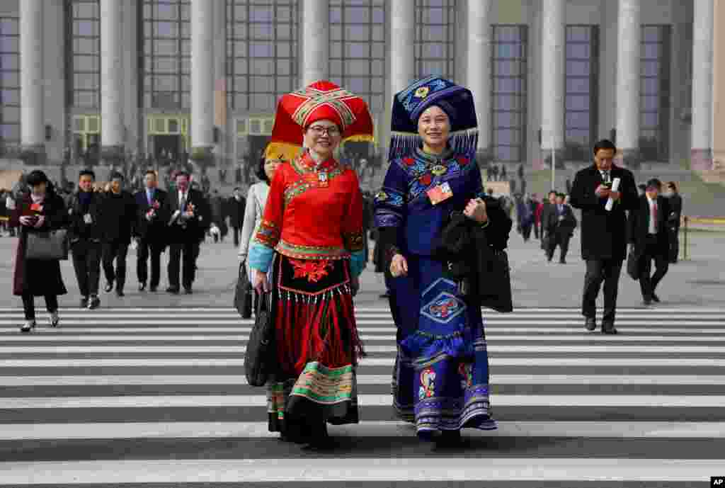 Delegates leave after attending a plenary session of China's National People's Congress (NPC) at the Great Hall of People in Beijing.