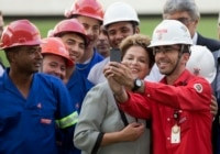 Dilma Roussef and construction workers.