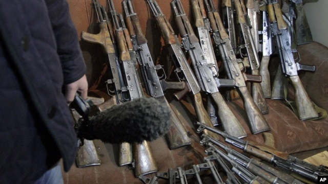 Arms, confiscated from the Garda World private security company, are shown to media in Kabul, Afghanistan, January 5, 2012.