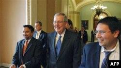 Senate Minority Leader Mitch McConnell, R-Ky., center, walks on Capitol Hill in Washington, 15 Nov 2010