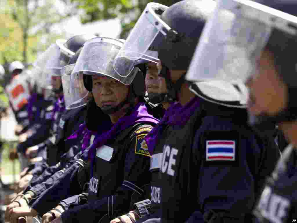 Riot police stand guard outside an air force academy compound that anti-government protesters had entered earlier in Bangkok, May 15, 2014.
