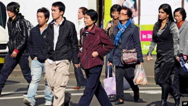 Shoppers walk through Sydney's Chinatown, August 2, 2010