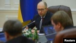 Ukraine's new prime minister Arseny Yatseniuk chairs a meeting in Kyiv, Feb. 27, 2014.