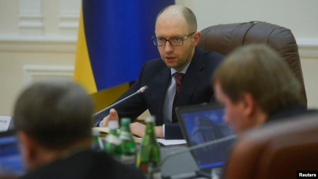 Ukraine's new prime minister Arseny Yatseniuk chairs a meeting in Kyiv, Feb. 27, 2014.