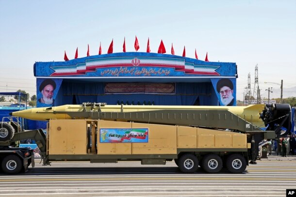 FILE - An Emad long-range ballistic surface-to-surface missile is displayed by the Revolutionary Guard during a military parade, in front of the shrine of late revolutionary founder Ayatollah Khomeini, just outside Tehran, Sept. 21, 2016.