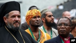 Various leaders from different faith communities attend the faith-based Climate Justice Rally at the ABSA Kingspark Rugby stadium in Durban, November 27, 2011.