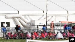 Immigrant children are shown outside a former Job Corps site that now houses them, June 18, 2018, in Homestead, Florida.