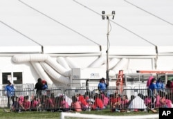 Immigrant children are shown outside a former Job Corps site that now houses them, in Homestead, Florida, June 18, 2018. The U.S. in the last six weeks has separated more than 2,300 young children from their families at the U.S.-Mexico border.