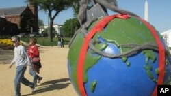 Globes showing environmental challenges are lining the National Mall for Earth Day activities.