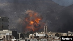 An airstrike hits a military site controlled by the Houthi group in Yemen's capital, Sana'a, May 12, 2015.